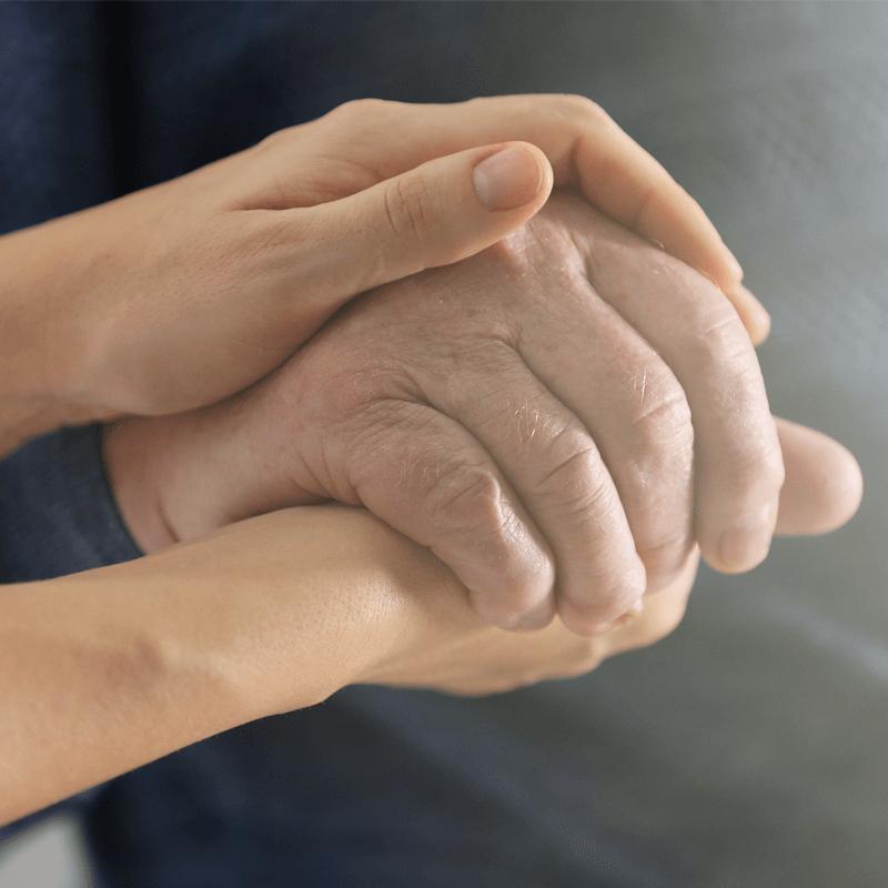 holding mans hand